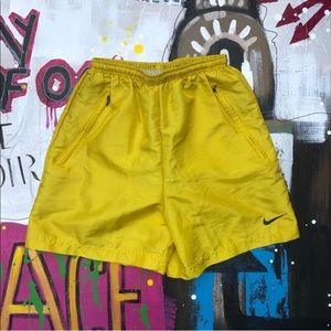 Yellow lined Nike running shorts
